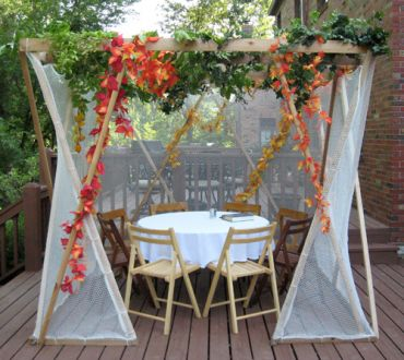 Standard-size sukkah with table and 8 seats.  See photos below showing 6 seats, 4 seats, and fabric detail.